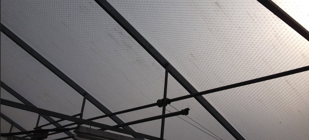 Greenhouse plastic covering 30 year old SolaWrap film